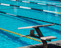Swimming starting blocks at outdoor pool Stock Image