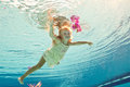 Swimming under the water girl with flower Royalty Free Stock Photo