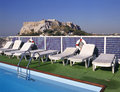 Swimmingpool and at background the acropolis rooftop of hotel with athens greece Stock Photo