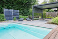 Swimmingpool with outdoors shower and trendy sunloungers appeltern the netherlands july the gardens of appeltern is the Royalty Free Stock Image