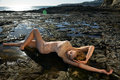 Swimsuit model posing sexy in front of black lava field on at palos verdes ca Stock Photo