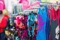 Swimsuits and bikinis on stands in supermarket Royalty Free Stock Photo