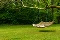 Swing bench in lush garden