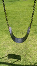 Swing seat hanging from chains Royalty Free Stock Photo