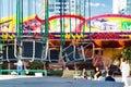 Swing seats hanging on long chains. Children`s amusement Park