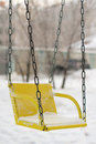 Swing in a  snow Stock Photo