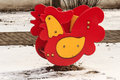 Swing spring rooster on kid playground outdoor a winter in the city Stock Images