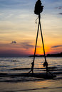 Swing in twilight on beach Royalty Free Stock Photography