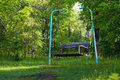 A swinging bench in the woods Royalty Free Stock Photos