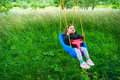 Swinging Outdoors In Garden