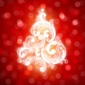 Swirly Christmas tree on bokeh background. Royalty Free Stock Photos