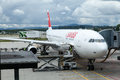 Swiss airlines aircraft a airplane connected to a finger in zurich airport Royalty Free Stock Photo