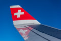Swiss airlines aircraft the tip of the wing of a airplane reflected on the wing Stock Photography