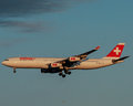 Swiss airlines plane approaches the runway image taken from color slide Royalty Free Stock Images