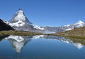 Swiss alps matterhorn and the dent blanche with their reflections in a lake in the southern above zermatt on a beautiful sunny day Stock Photography