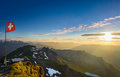 Swiss alps at sunset panoramic view over mountains during with flag Royalty Free Stock Photography