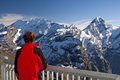 In the swiss alps switzerland woman looking from a viewpoint at Royalty Free Stock Images