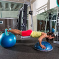 Swiss ball bosu push up woman blue fitball Royalty Free Stock Photo