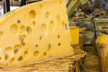Swiss cheese on display at a market in provence france Stock Photos