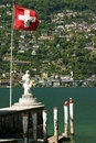 Swiss flag over the Lake Maggiore Stock Photos
