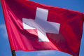 Swiss flag switzerland s national blowing in the wind Stock Image