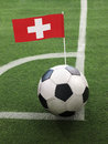 Swiss flag on top of soccer ball Royalty Free Stock Photos