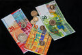 Swiss Franc money on black, coins and banknotes