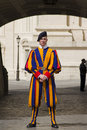 Swiss guard outside vatican city state april pontifical dressed in the renaisance style uniform on duty the Stock Photo