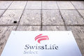 Swiss life select swisslife sign on a building with copy space above it Stock Photography