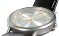 Swiss made watch face titanium case flat sapphire glass gold grey classic style luxury men's wristwatch detailed macro closeu Royalty Free Stock Photo