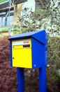 Swiss outdoor private postbox with yellow and dark blue colors Royalty Free Stock Images