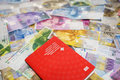 Swiss passport and money currencies Royalty Free Stock Photography
