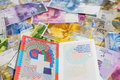 Swiss passport and money currencies Royalty Free Stock Images