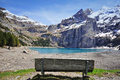 Swiss peaks and lake oeschinensee picks blue Stock Images