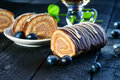 Swiss roll, blueberry and tea Royalty Free Stock Photo