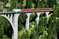 Swiss train on very high bridge Royalty Free Stock Photo