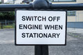 Switch engine off a sign on a metal railing Stock Images