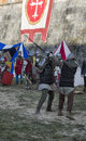 Sword fight between knights in historical re-enactment Royalty Free Stock Photo