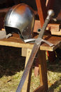 Sword and helmet medieval weaponry Royalty Free Stock Photo