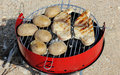 Swordfish barbecue bbq sword fish and potatoes on a red grill Royalty Free Stock Image