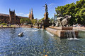 Sydney australia landmark hyde park day time archibald fountaine water sunny reflection trees cathedral Royalty Free Stock Photo
