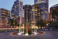 Sydney cbd modern fountain city australia landmarks at sunset flowing illuminated in the street with skyscrapers in background Royalty Free Stock Images