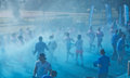 Sydney color run australia august competitors in the fun in centennial park runners are doused in coloured powder bubbles and Stock Photo