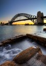 Sydney harbor bridge harbour with rocks in the foreground Royalty Free Stock Photos