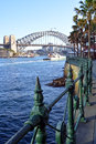 Sydney harbour bridge from circular quay with railings detail and north in the background Stock Photos