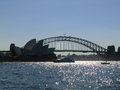 Sydney harbour bridge and opera with in front picture taken against the light Royalty Free Stock Photo