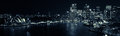 Sydney Harbour by night panorama in black and white Royalty Free Stock Photo