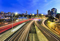 Sydney motorway lights domain city suburb at sunset view above cross city toll road when car headligths are blurred and buildings Royalty Free Stock Images