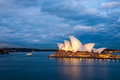 Sydney opera house at blue night australia july view of the with nice clouds sky background Stock Photography