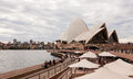 Sydney opera house on a cloudy day australia july is multi venue performing arts centre also containing bars and outdoor Stock Images